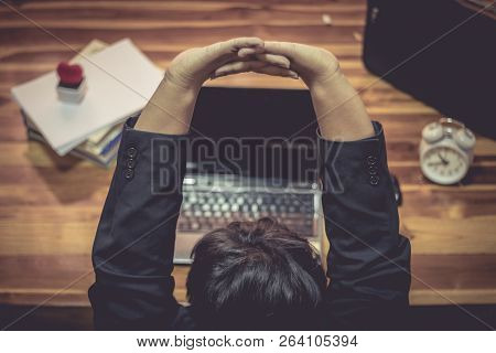 Businessman Has Been Relax. The Successful Work And The Computer On The Table