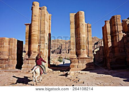 Petra, Jordan - November 12, 2015: Unidentified Local Jordanian Man Rides A Horse In Petra, Jordan.
