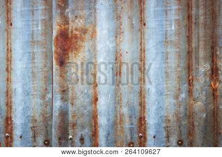 Background Of Peeling Paint And Rusty Old Metal. Zinc Wall Texture Pattern Background Rusty Corrugat