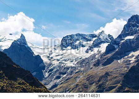 Travel To North Caucasus Region Region - Snow Fields On Mountain Tops Near Dombay Resort Village In