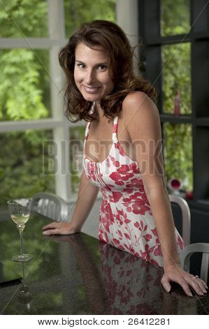 Cheerful beautiful young woman in home kitchen