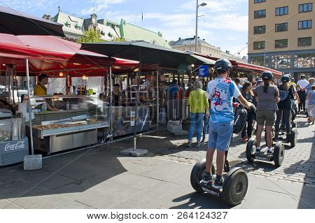 Bergen, Norway - July 15, 2018: Tourists Riding Segways At The Fish Market In Bergen