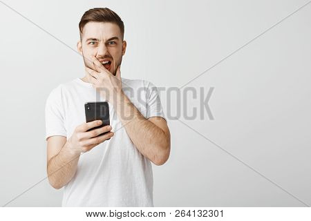 Shocked Stunned Handsome Guy Opening Up Terrible Photo Of Ex-girlfriend Shouting From Dislike And Su