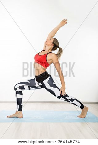 Yoga Instructor Does Assans. Sporty Young Woman Doing Stretching Exercises And Yoga Practice