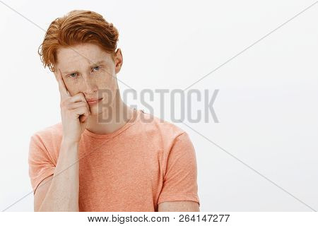 Cute Ginger Man Trying To Learn Foreign Language Sitting Intense And Serious In Class, Cannot Focus