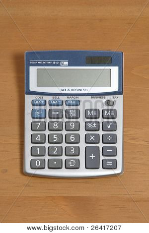 A calculator on a legal pad in an office
