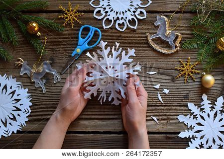 Making Paper Snowflakes With Your Own Hands. Children's Diy. Merry Christmas And New Year Concept. S