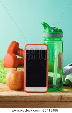 Fitness Background With Bottle Of Water, Dumbbells And Smart Mobole Phone On Wooden Table. Mock Up T