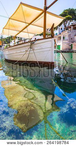 Idyllic View Of Old Fisher Boat At Coast Bay Of Cala Figuera On Mallorca, Balearic Islands