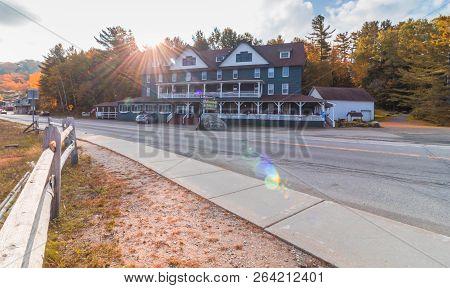Long Lake, Ny, Adirondacks, October 9, 2018:  Adirondack Hotel At Sunrise In The Fall