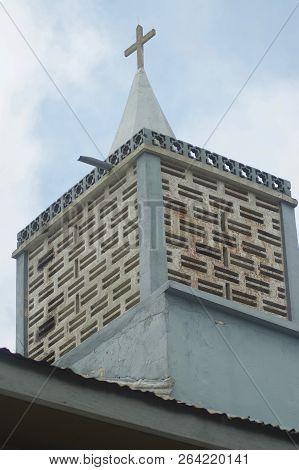 Abetifi, Ghana: July 23rd 2016 - A Square Church Tower In Rural Ghana.