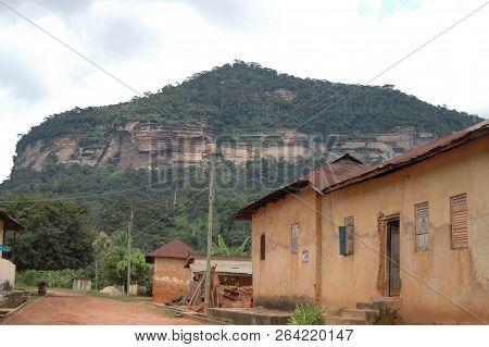 Abetifi, Ghana: July 23rd 2016 - Buildings And Forested Slope Near Abetifi, Ghana