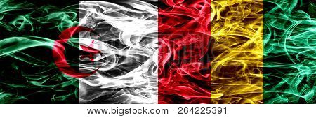 Algeria, Algerian Vs Guinea, Guinean Smoke Flags Placed Side By Side. Concept And Idea Flags Mix