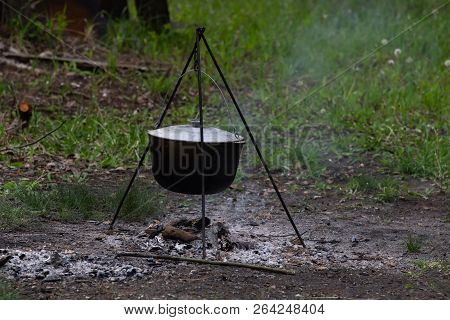 Cooking In Field Conditions, Boiling Pot At The Campfire On Picnic