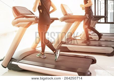 People Running In Machine Treadmill At Fitness Gym Club,