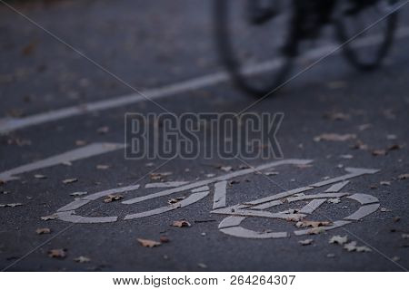 Oblique View On Cycle Path In Early Morning Light With Bicycle - Urban Commuting Concept - Blurred B