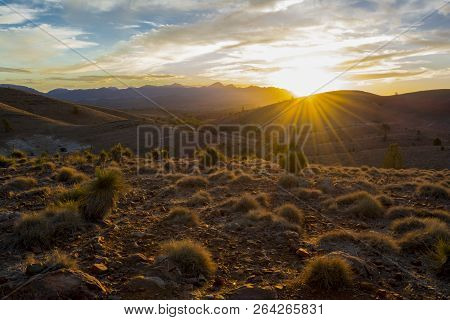 Scenic Sunset View With Sunburst From Over The Mountain Ranges At Hucks Lookout Within The Ikara-fli
