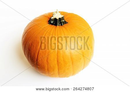 Beauty Yellow Pump-kin On A White Background