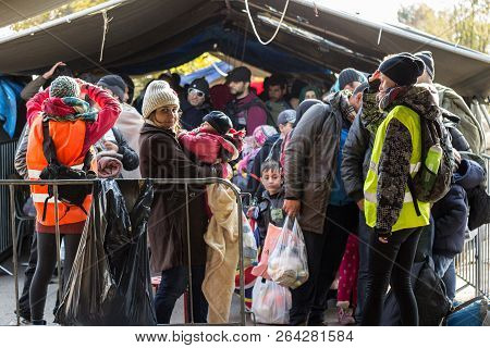 Berkasovo, Serbia - October 31, 2015: Refugee Woman Holding Her Child, A Baby, Standing In The Middl
