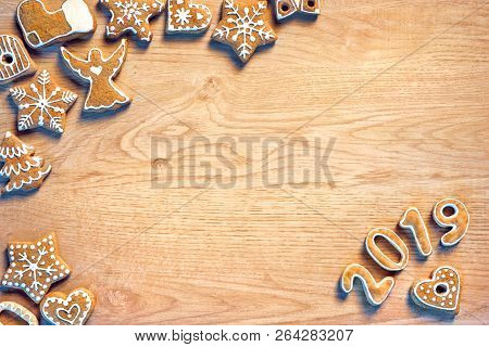 Merry Christmas And Happy New Year! Homemade Ginger Cookies On Wooden Table. Copy Space For Your Tex