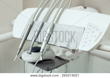 Closeup of a modern dentist tools, burnishers with blurred background poster