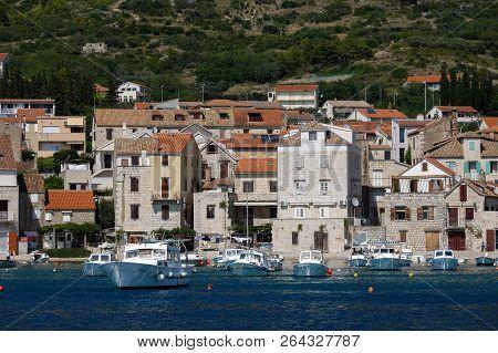 Komiza, Croatia, July 27, 2018: Komiza, A Croatian Town With 17th And 18th Century Stone Town Houses