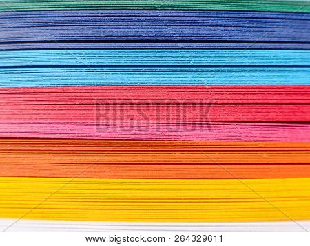 Colored Paper, Cross Section. Paper Strips In Rainbow Colors As A Colorful Backdrop. The Colored Pap