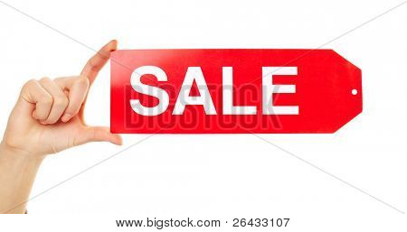Close-up of female hand holding red sale tag in isolation