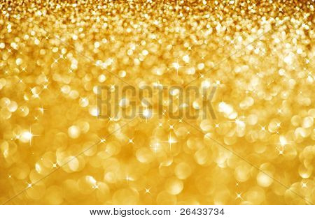 Christmas Golden Glittering background.Holiday Gold abstract texture.Bokeh
