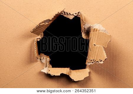Cardboard with a hole - black background