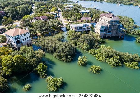Entire Neighborhood Flooded And Under Water , Straight Down Aerial Drone Angle Above Flooded Mansion
