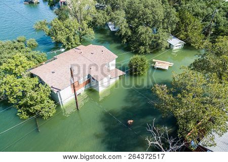 Aerial Drone View Of Historic Flooding Home Under Water Or House Under Flood Water , Lake Travis , O
