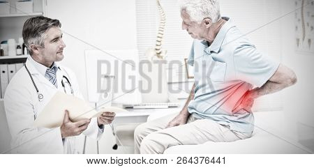 Highlighted pain against doctor discussing reports with patient suffering from back pain