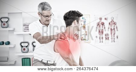 Highlighted pain against physical therapist examining patient shoulder