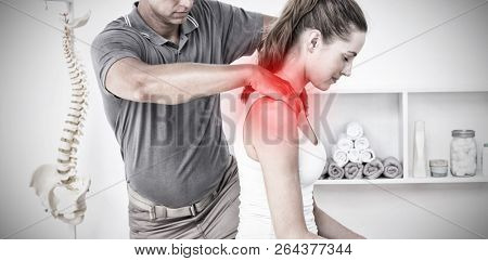 Highlighted pain against doctor doing neck adjustment