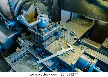 Metal Lathe Processes Metal Parts On The Production In The Plant. The Work Process Of The Lathe. Clo