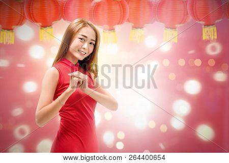 Beautiful Chinese Woman With Cheongsam Dress And Congratulation Gesture. Happy Chinese New Year