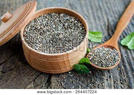 Healthy Chia Seeds In A Wooden Bowl On Old Rustic Wooden Table With A Spoon. Fitness Dietary Super F
