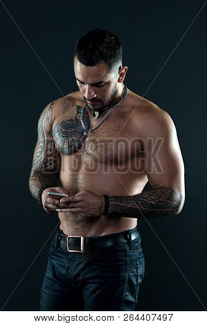 Send Message. Handsome Fit Man Send Message Smartphone. Muscular Tattooed Athlete Look Attractive. M