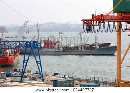 Petropavlovsk Kamchatsky, Kamchatka Peninsula, Russia - Nay 20, 2018: Ships At Pier, Port Cranes On