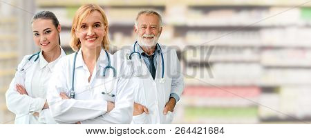 Doctors At Hospital Working With Other Doctor. Healthcare Medical And Doctor Staff Services.