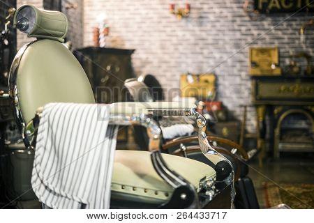 Vintage Elegant Aquamarine And Silver Chair In Stylish Barber Shop