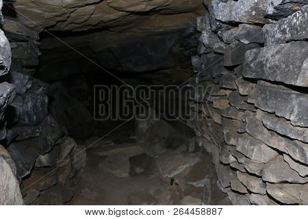 Abandoned Galleries Mining And Processing Of Natural Stone In The Cave. Caves And Dark Stone Tunnels
