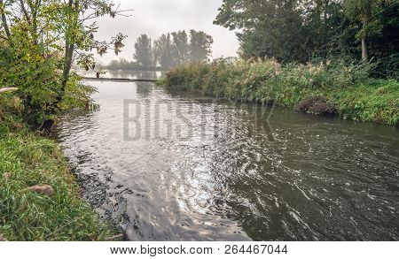 Strongly Flowing Water In A Creek Near The Outflow Opening Of A Pumping Station In A Dutch Polder. I