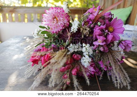Bouquet Of Purple Wild Flowers On A Table