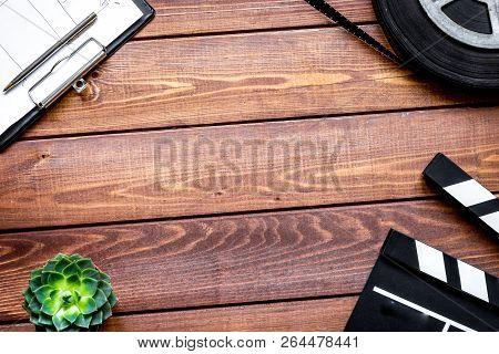 Screenwriter Desktop With Movie Clapper Board Wooden Background