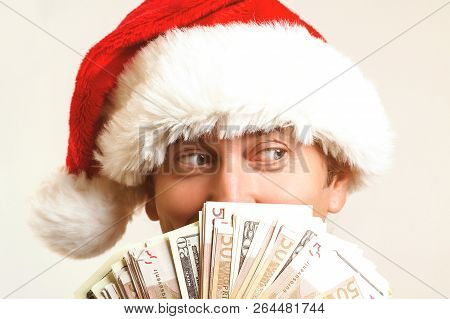 Santa Claus With Dollar Money, Isolated On White. Christmas, Holidays, Winning, Currency And People
