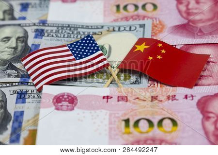 Usa Dollar Banknotes And China Yuan Banknotes With Across Of United States Of America Flag And China