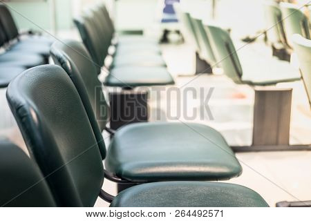 Empty Green Chairs In Waiting Room At Clinic Or Hospital. Health Care Concept