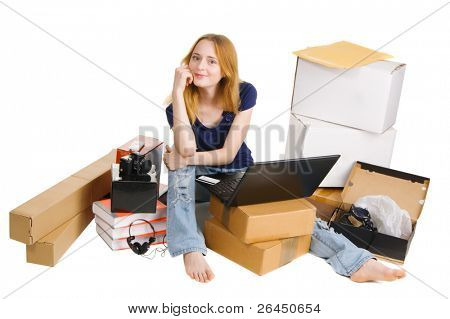 Young girl surrounded by her delivered online orders